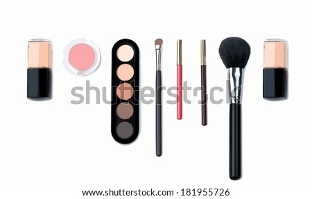 Isolated beautiful nude cosmetics and brushes for women - stock photo
