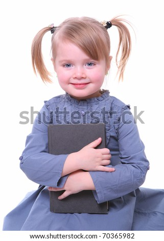 isolated beautiful young girl sitting with a book - stock photo