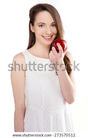 isolated beautiful young woman eating an apple on white background - stock photo