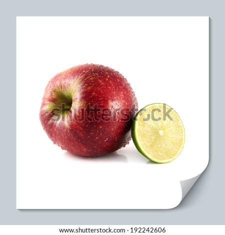 Isolated big red apple with half of lime on a white background (water drops). Fresh diet fruit. Healthy fruit with vitamins.