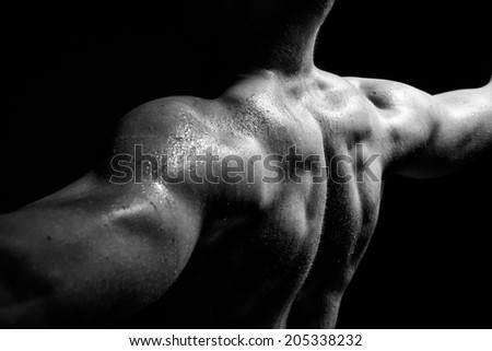 Isolated black and white muscle man - stock photo