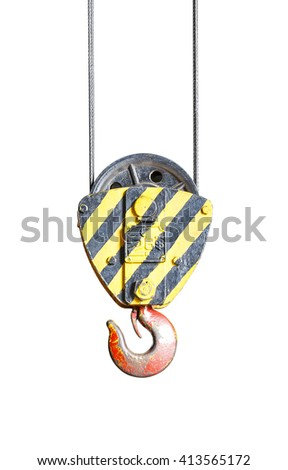 Isolated black and yellow cranes hooks hanging on steel with clipping path - stock photo
