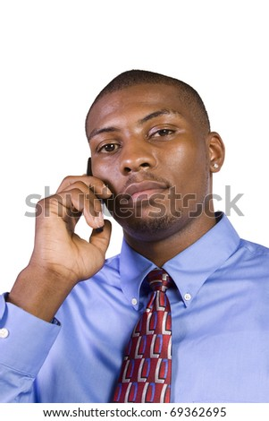 Isolated Black businessman with his hand in pocket talking on the phone - stock photo