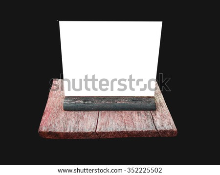 Isolated blank wooden nameplate isolated  isolated on a black background. - stock photo