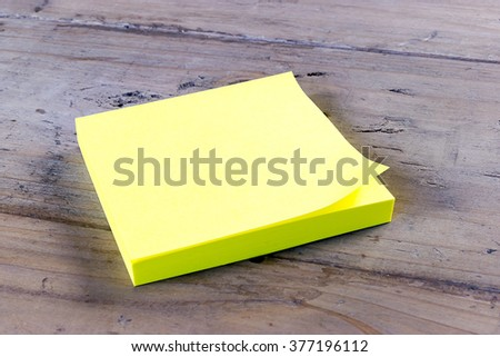 Isolated Block of Yellow Post it Notes  - stock photo