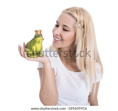 Isolated blonde woman holding a frog in her hand - concept for love. - stock photo