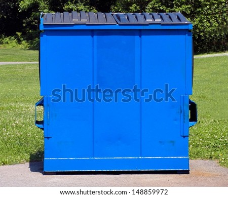 Isolated blue dumpster - stock photo