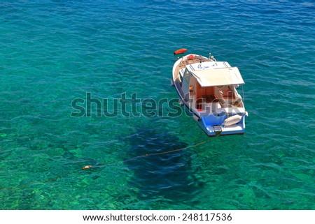 Isolated boat on the shores of Adriatic sea, Croatia - stock photo