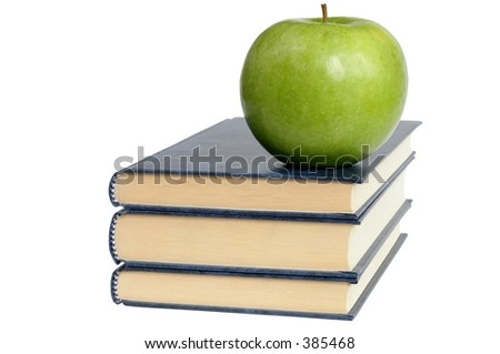 Isolated books and apple.