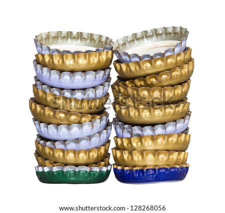 Isolated bottle caps of beer at the many layers of overlapping rows. - stock photo