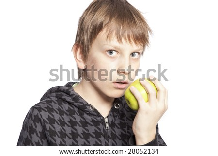 isolated boy eating apple over white background