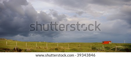 Isolated bright red house on plane, Isle of Skye, Scotland - stock photo