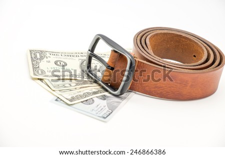 Isolated brown leather bag with belt and currency / money on white background