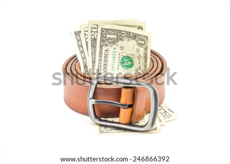 Isolated brown leather bag with belt and currency / money on white background  - stock photo
