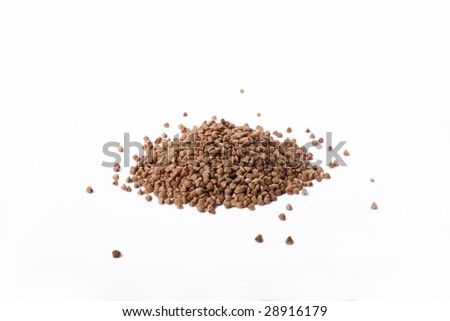 Isolated buckwheat on white background. Handful of grain - stock photo
