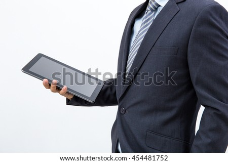 isolated business man hold the tablet on white background