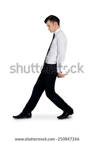 Isolated business man pushing something - stock photo