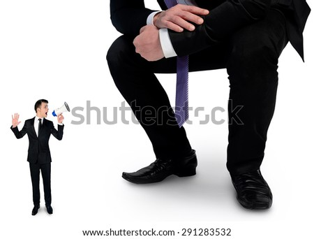 Isolated business man screaming on megaphone at boss - stock photo