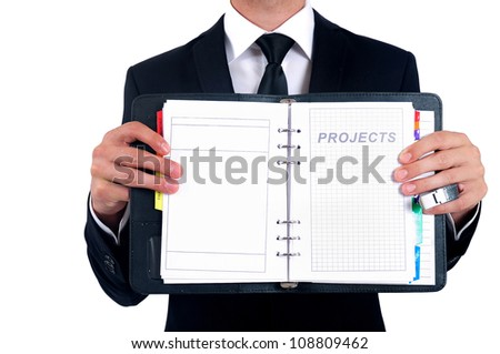 Isolated business man showing agenda page