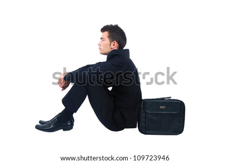 Isolated business man sitting with briefcase