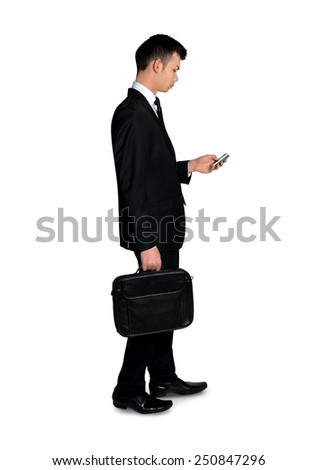 Isolated business man using phone