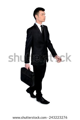 Isolated business man walk side view - stock photo