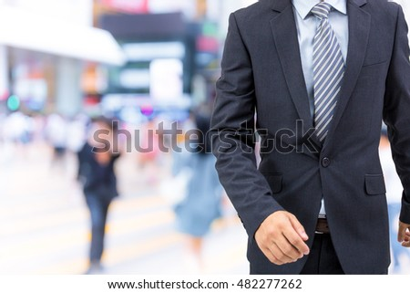 isolated business man walking on the street