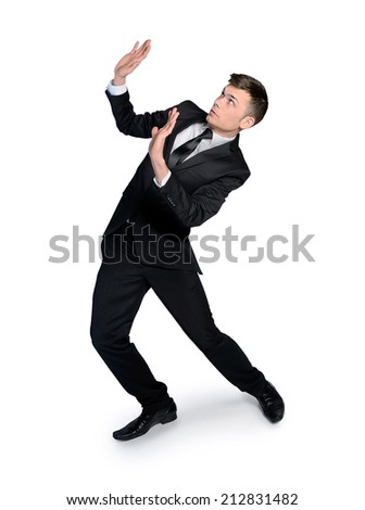isolated business man with hands up - stock photo