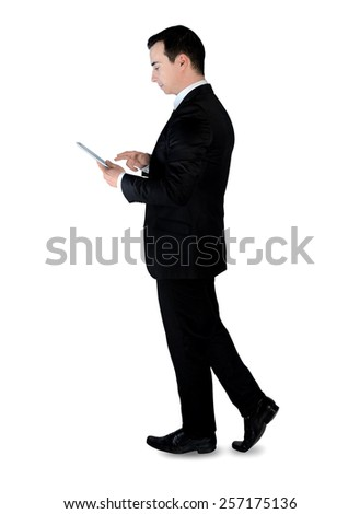 Isolated business man with tablet - stock photo