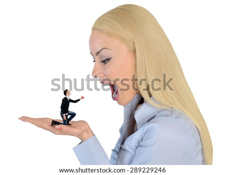 Isolated business woman looking shocked on little man - stock photo
