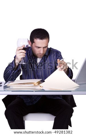 Isolated Businessman At His Desk Working and Drinking Wine- White Background