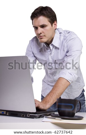 Isolated Businessman browsing internet on laptop at work - stock photo