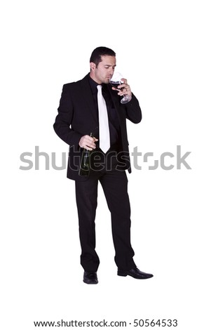 Isolated businessman celebrating by pouring more drink to himself