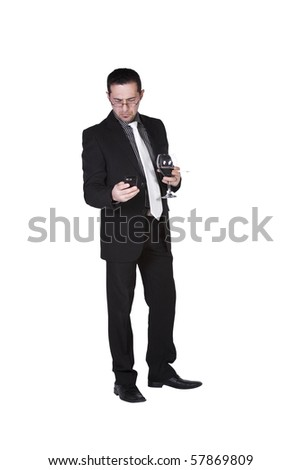 Isolated businessman celebrating with a glass of drink and a cigarette while talking on the phone