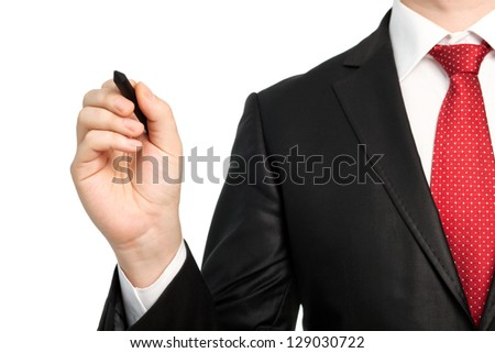 Isolated businessman in a suit with a red tie holding a pen and writing something - stock photo