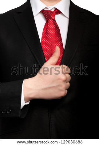 Isolated businessman in a suit with a red tie shows well - stock photo