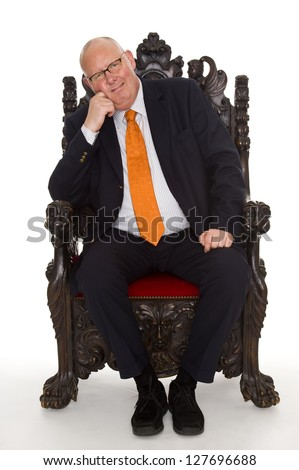 isolated businessman sitting on a throne