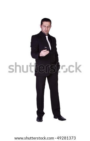 Isolated businessman texting on his cell phone - stock photo