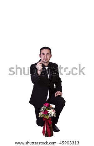 Isolated Businessman with Flowers Holding an Engagement Ring Down on His Knee Proposing