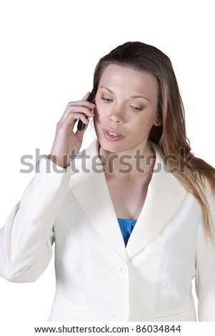 Isolated Businesswoman at Talking on the Cell Phone at Work