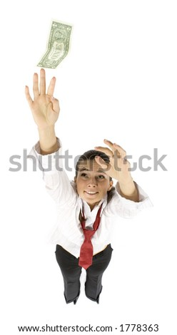 isolated businesswoman reaches dollar banknote - stock photo
