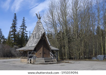 Isolated cabin in the woods - stock photo