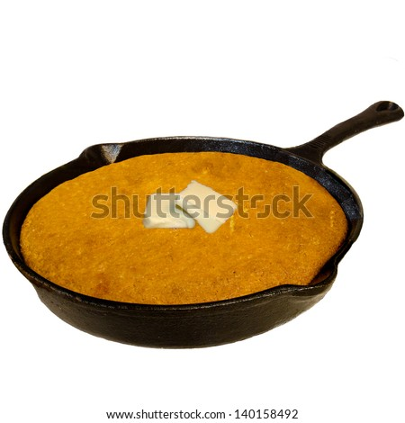 Isolated Cast Iron Skillet with Cornbread and Butter - stock photo