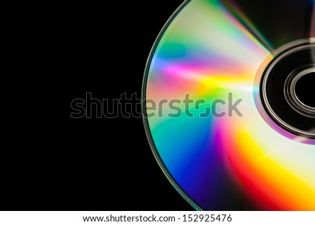 Isolated CD in black background. - stock photo