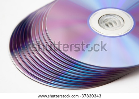Isolated cd or dvd pile - stock photo