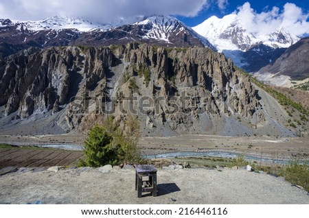 Isolated chair on the rooftop with Annapurna mountain range in the background