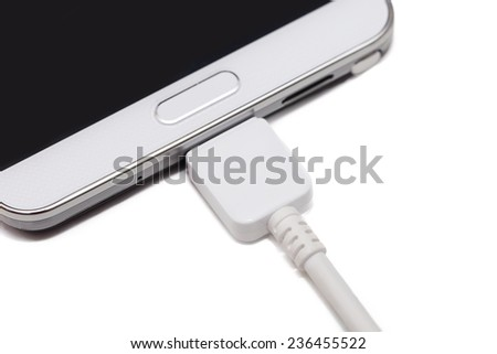 isolated charging  modern mobilephone on white background - stock photo