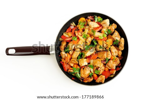 Isolated chicken with vegetable on frying pan - stock photo