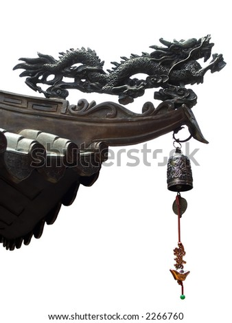Isolated chinese dragon and bell on the edge of a temple roof