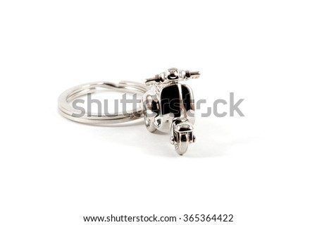 Isolated close up of keychain motorbike over white - stock photo